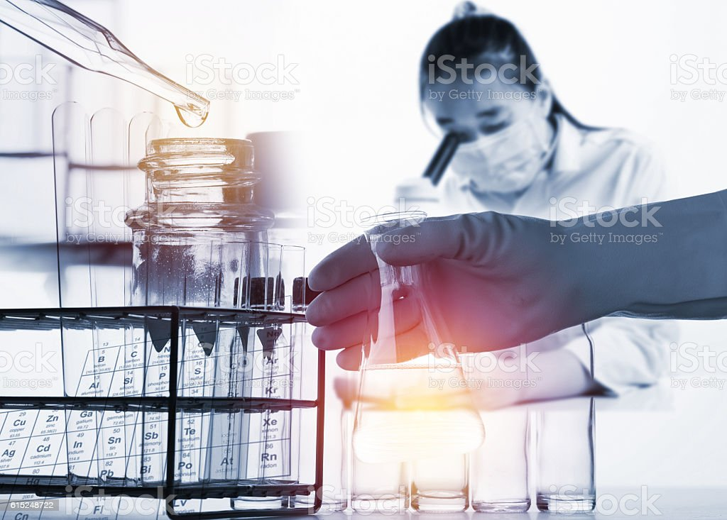 female medical or scientific researcher using her microscope stock photo