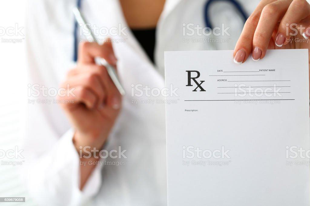 Female medicine doctor hand give prescription to patient stock photo