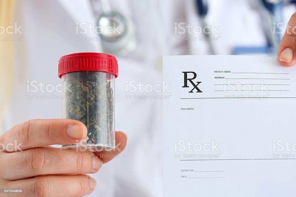Female medicine doctor hand hold medical marijuana stock photo