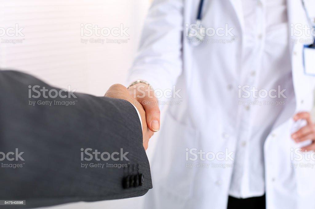 Female medicine doctor shake hand as hello stock photo
