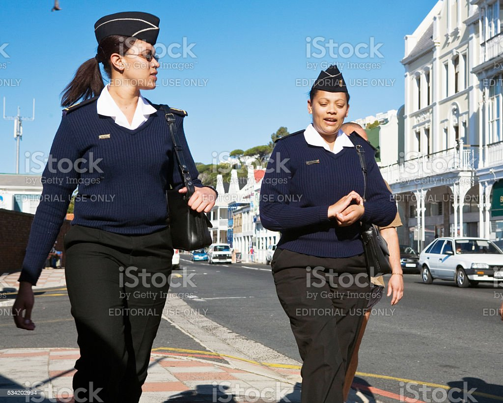 Female members of South African Navy walking in Simon's Town stock photo