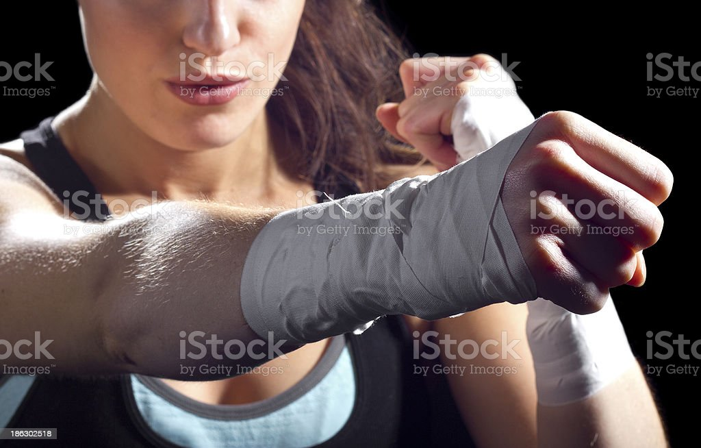 A female MMA fighter giving a strong punch stock photo