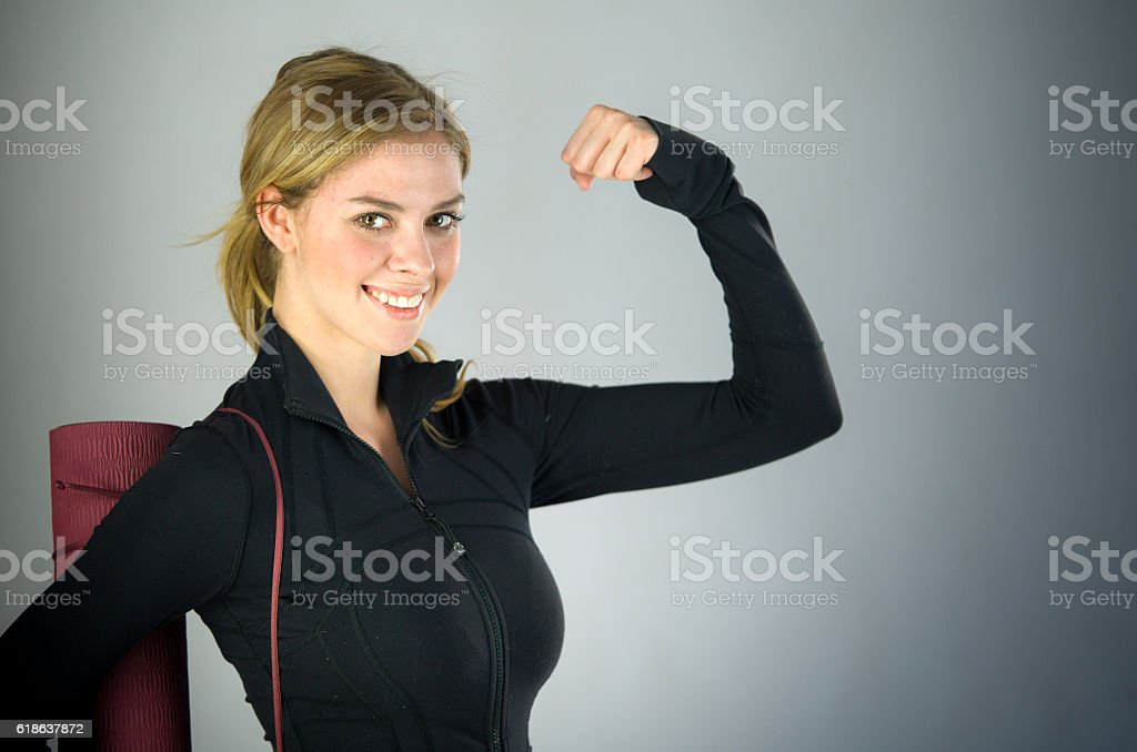 female model attractive woman showing strength with arm curl stock photo