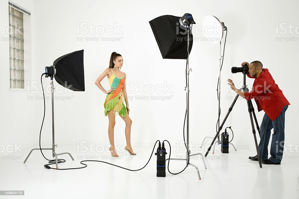 Female model being photographed by photographer. royalty-free stock photo