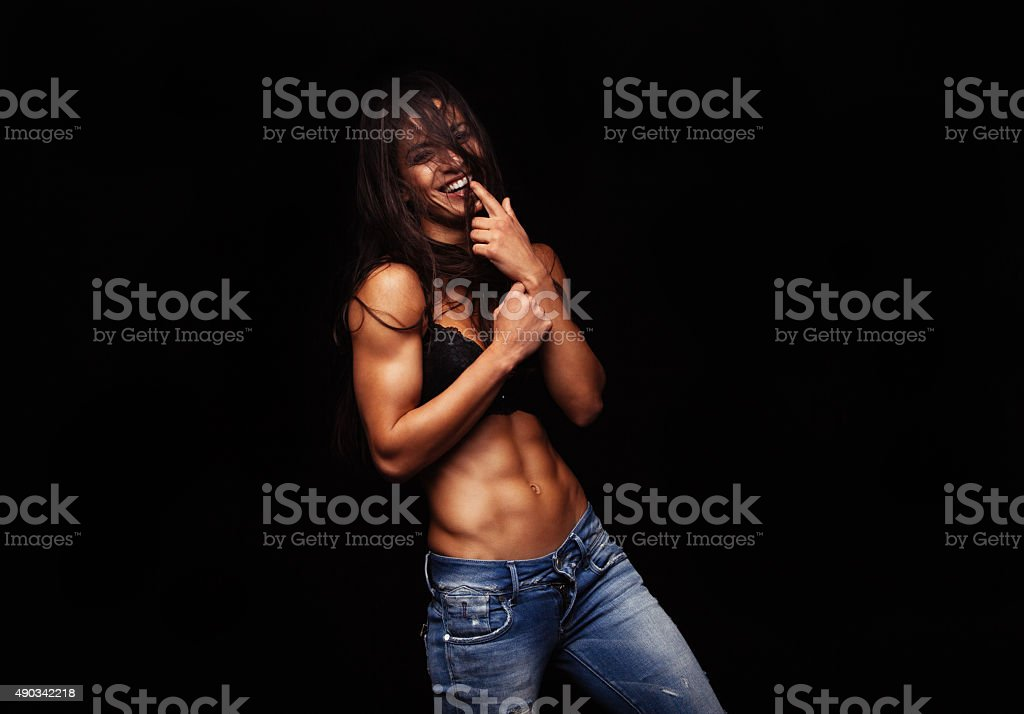 Female model posing in fashionable jeans and bra stock photo