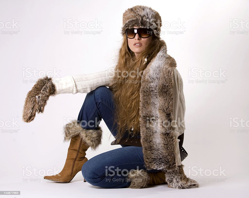 Female model posing with clothes for cold weather royalty-free stock photo