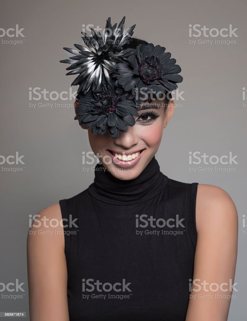 Female model wearing a high fashion black hat stock photo