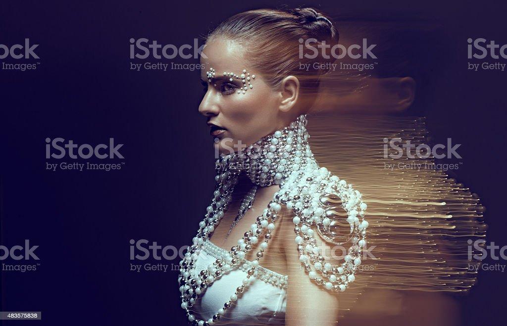 Female model wearing pearls jewellery stock photo
