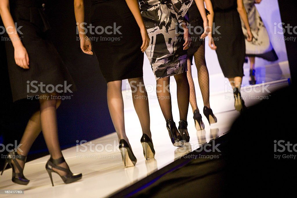 Female models at catwalk show stock photo