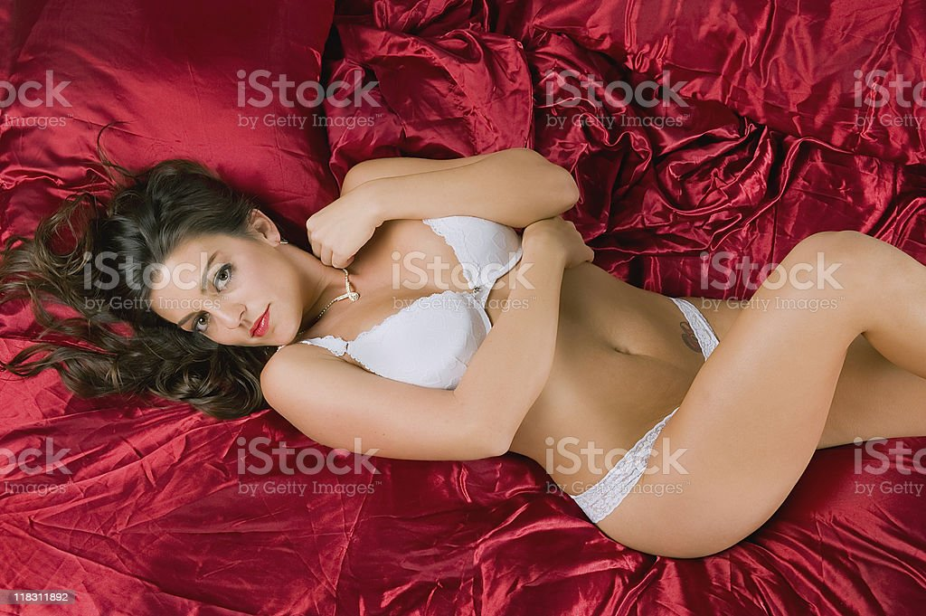 female models lingerie on red bed sheets royalty-free stock photo