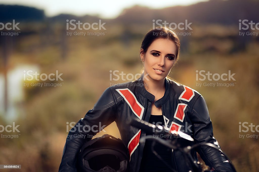 Female Motocross Racer Next to Her Motorcycle stock photo