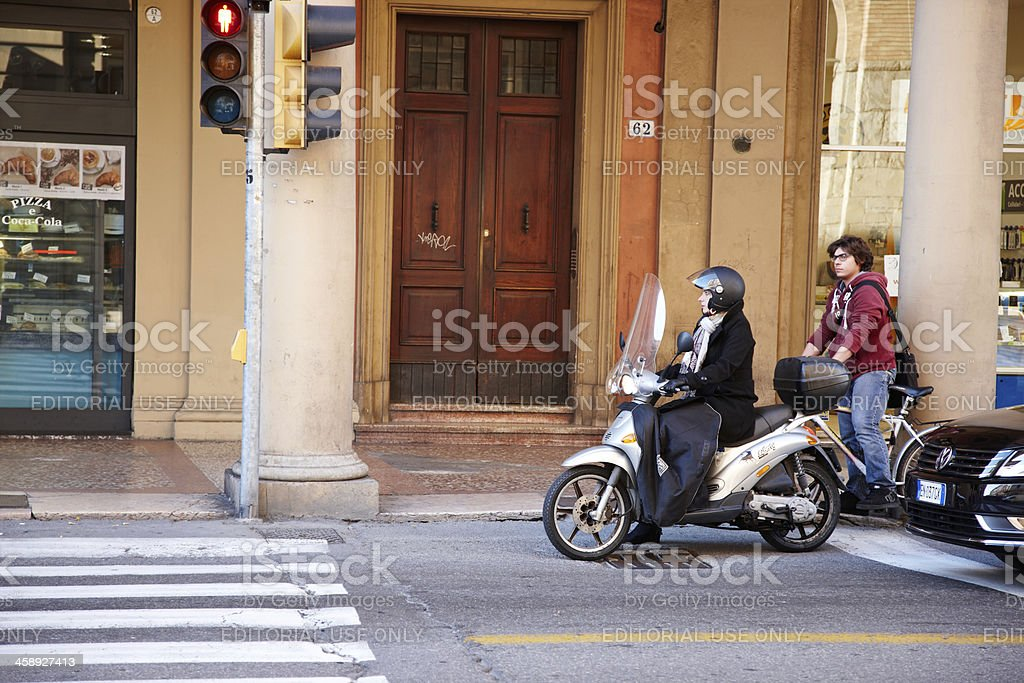 Female motorcyclist in Bologna royalty-free stock photo