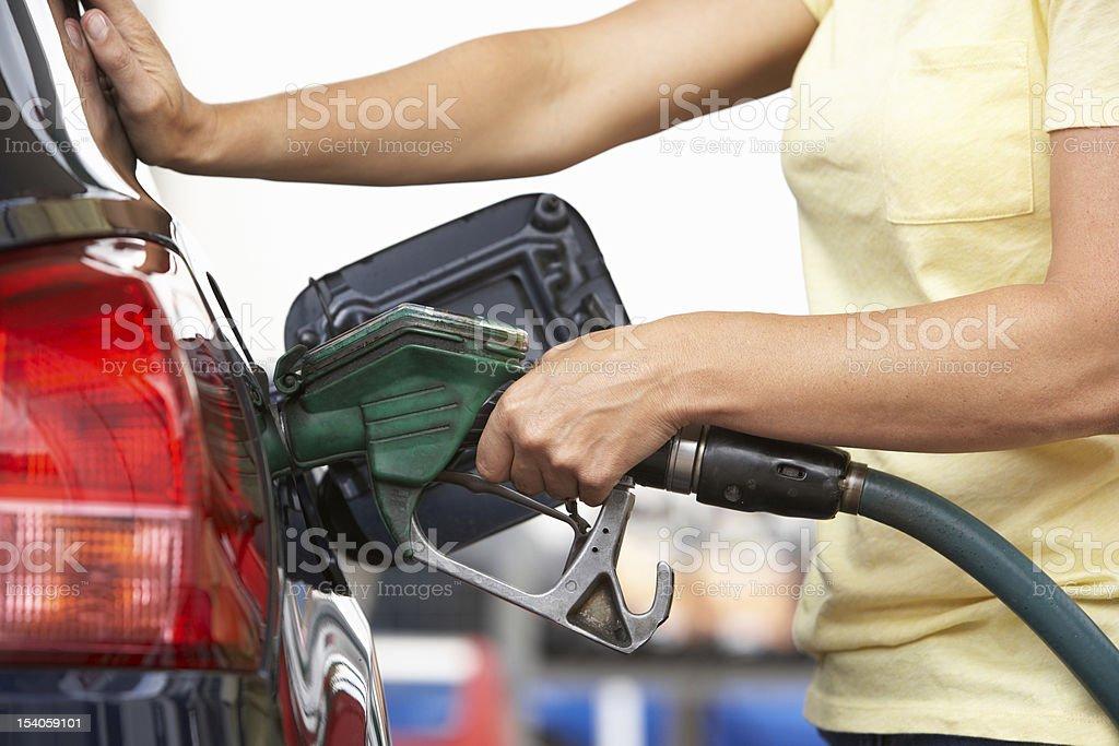 Female Motorist Filling Car At Petrol Station stock photo
