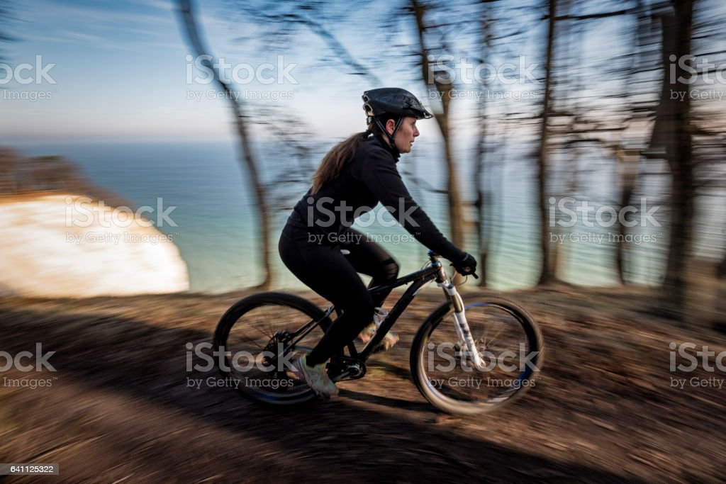 Female Mountain Bike Rider Out For a Training Ride. stock photo