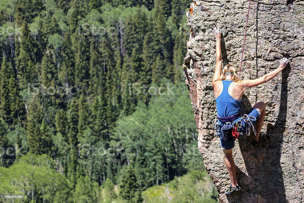 Female Mountain Climber on a Rock Face stock photo