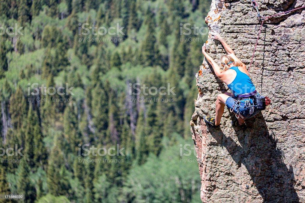 Female Mountain Climber on a Rock Face stock photo
