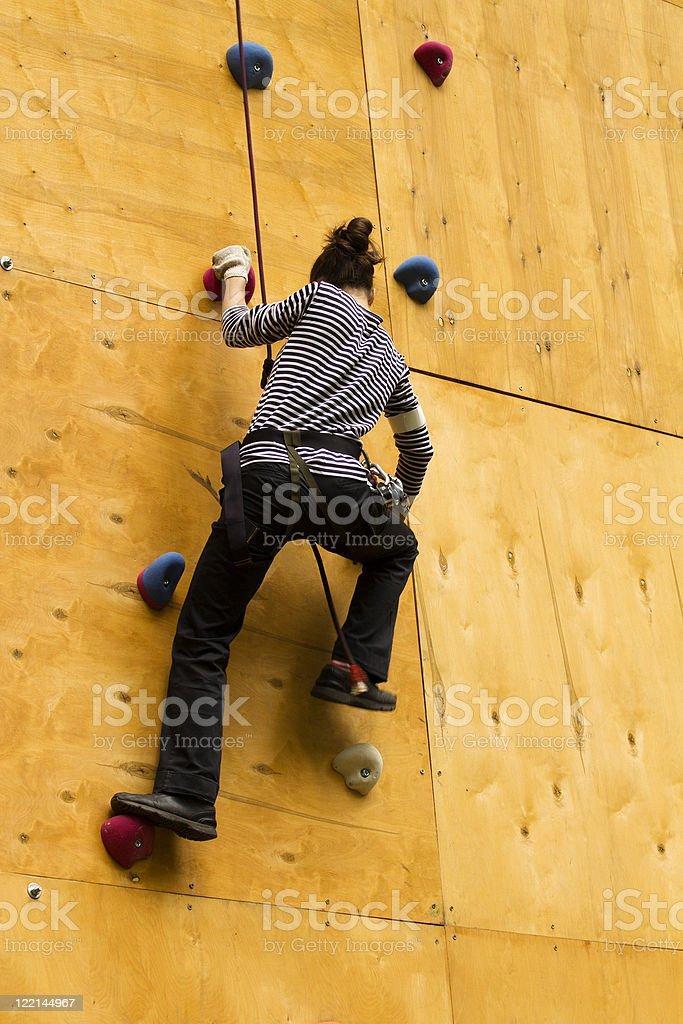 Female movement dangerous  height wall stock photo