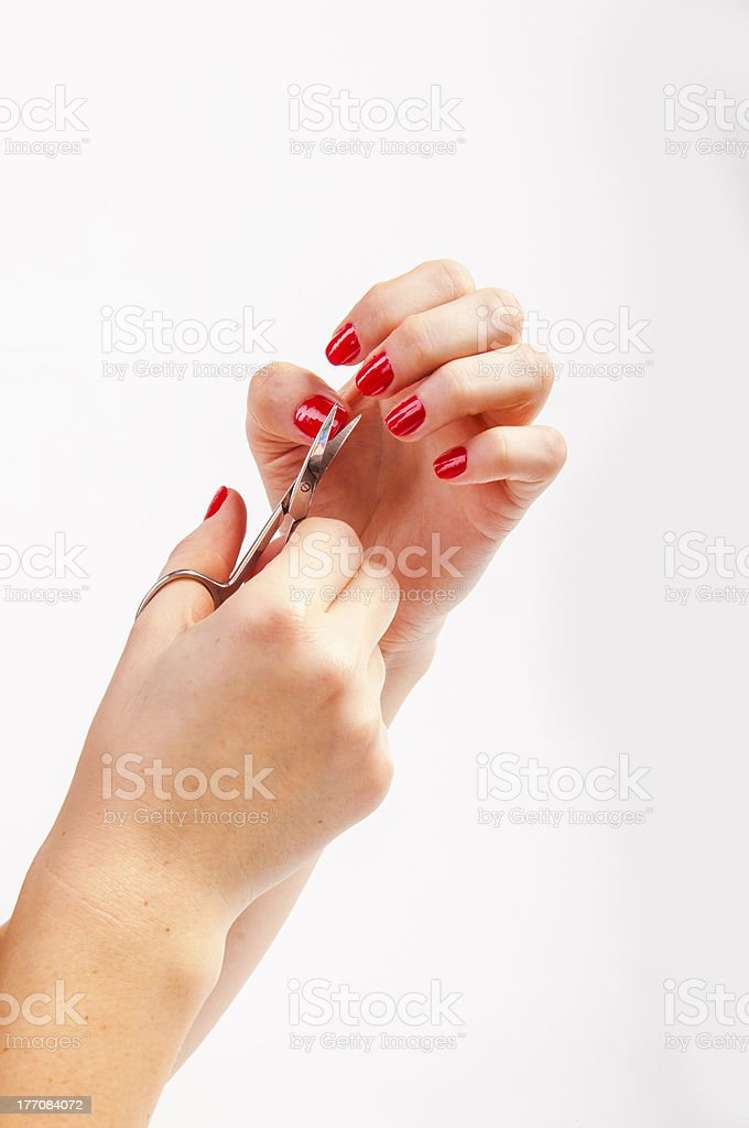Female nails and scissors royalty-free stock photo