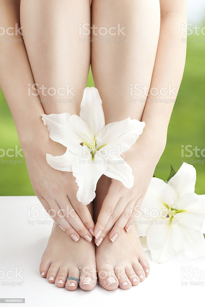 Female  Naked Legs and Arms with White Lilies stock photo