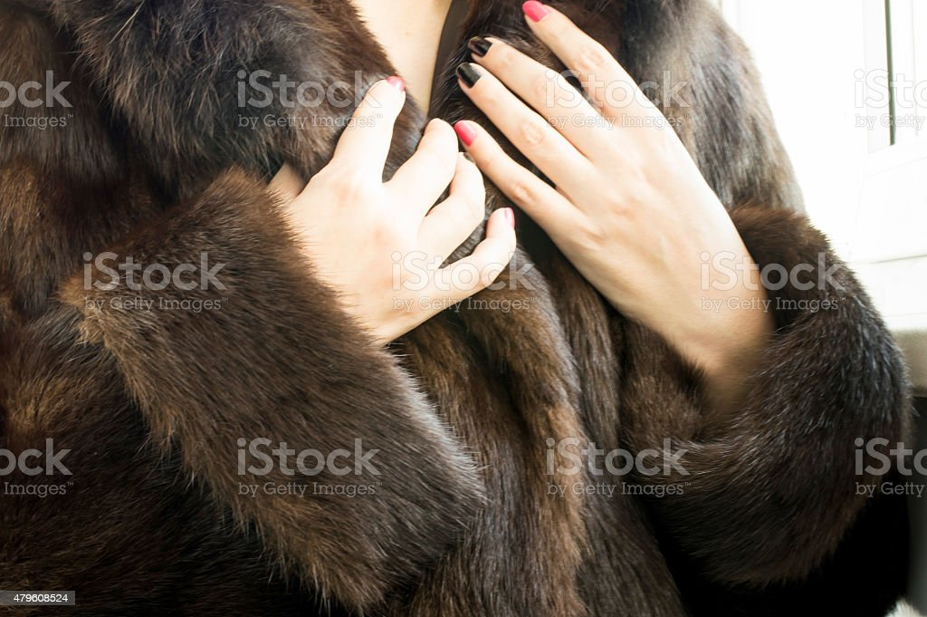 Female natural mink coat stock photo