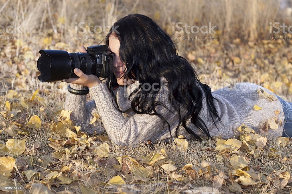 Female Nature Photographer Outdoors in Action royalty-free stock photo