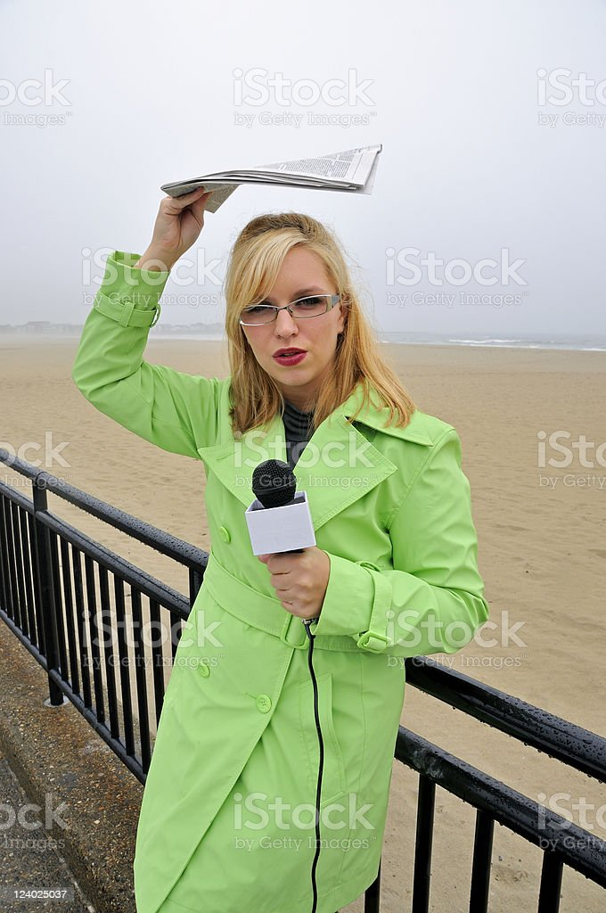 Female Newscaster Reports from Beach royalty-free stock photo