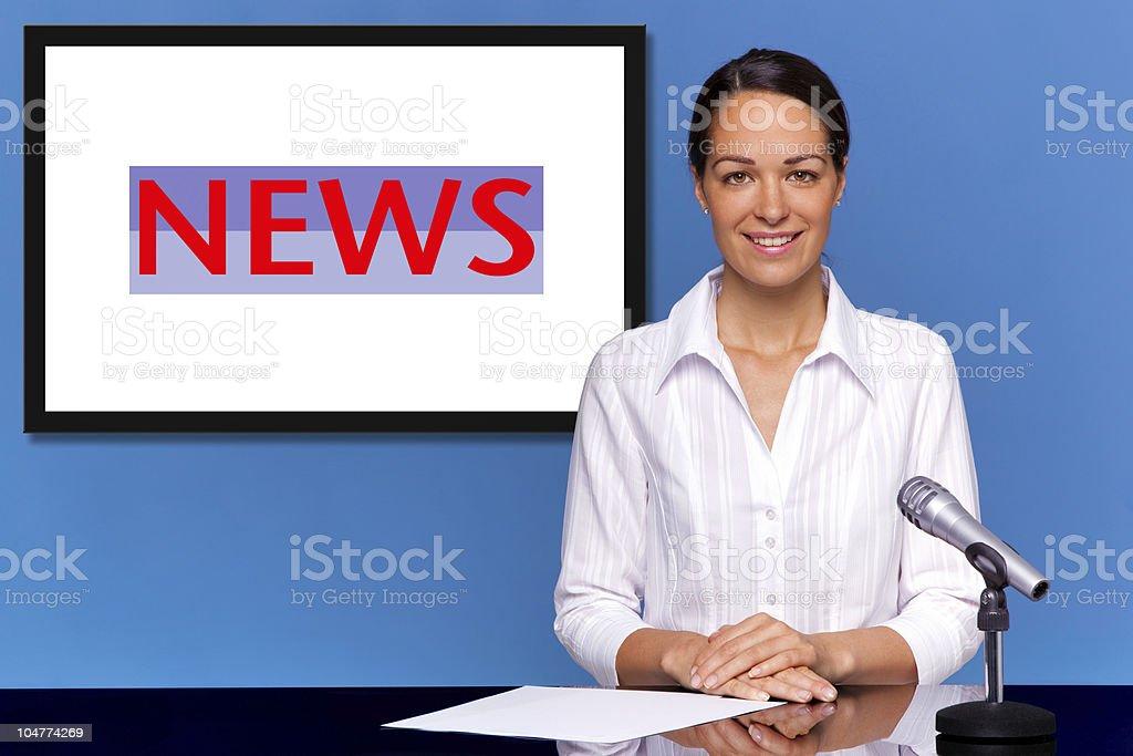 Female newsreader presenting the news stock photo