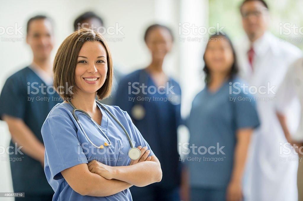 Female Nurse Happily at Work stock photo