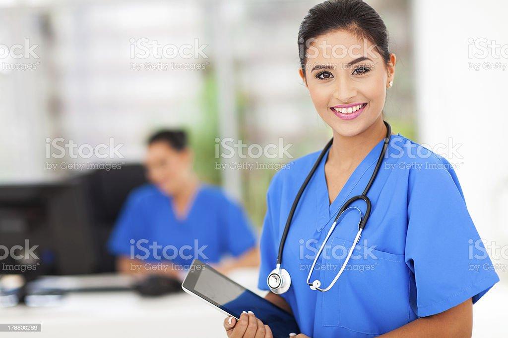 female nurse holding tablet computer stock photo