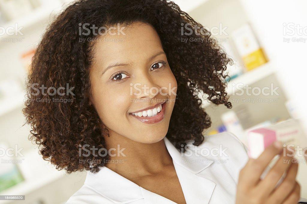 UK Female nurse in pharmacy royalty-free stock photo
