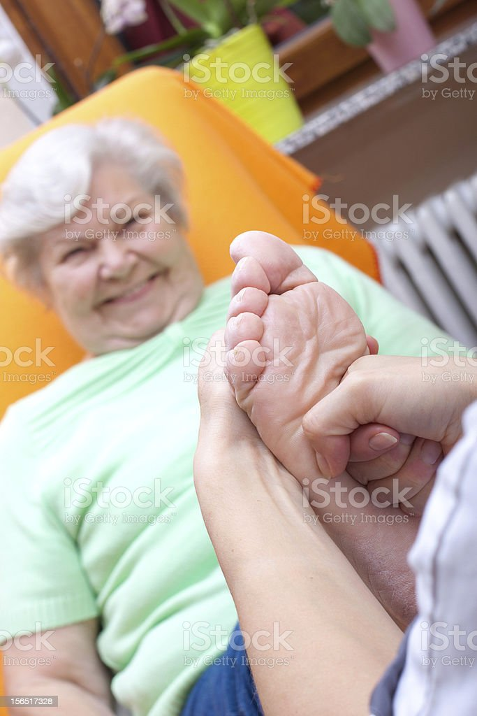 female Nurse massaging foot of a patient royalty-free stock photo