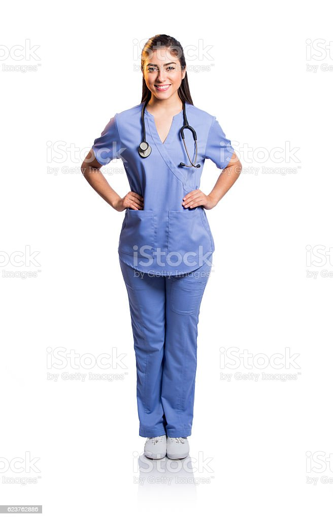Female nurse standing with hands on waist and smiling stock photo