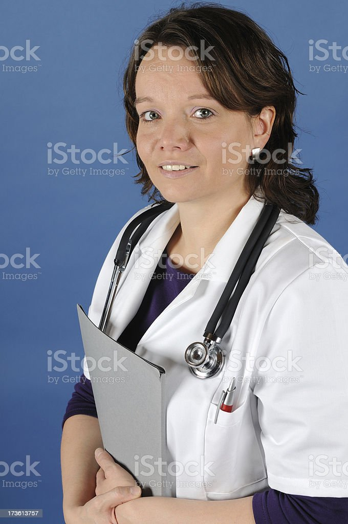 Female Nurse with Stethoscope and Booklet stock photo