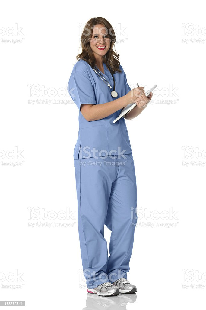 Female nurse writing on a note pad royalty-free stock photo