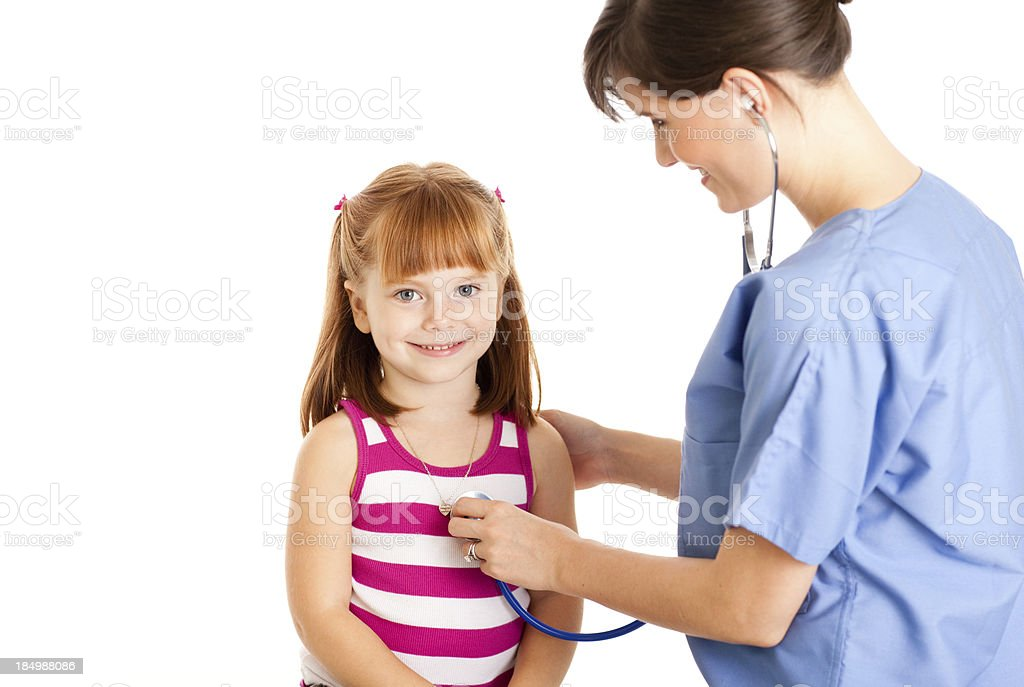 Female Nurse/Doctor Checking Heartbeat With Stethoscope of Happy Young Girl royalty-free stock photo