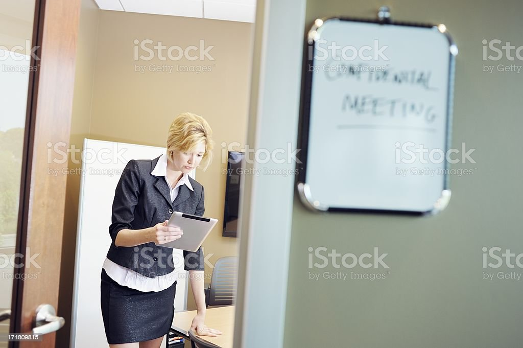 Female Office Worker in Meeting Room royalty-free stock photo
