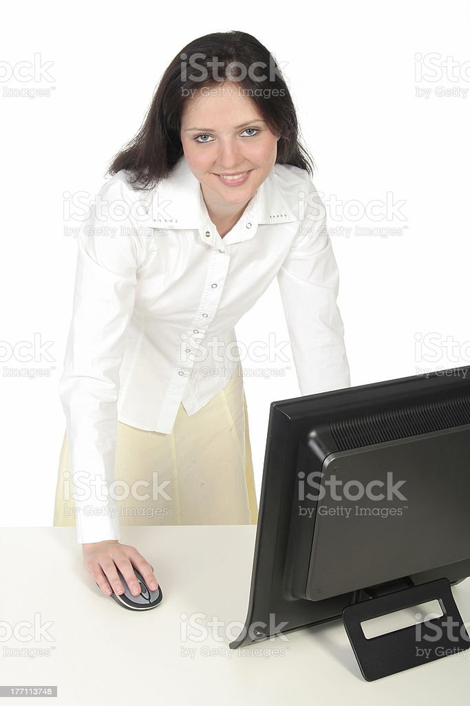 Female office worker standing behind her desk royalty-free stock photo