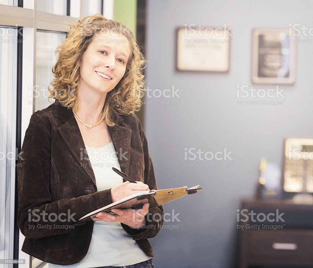 Female office worker with note pad royalty-free stock photo