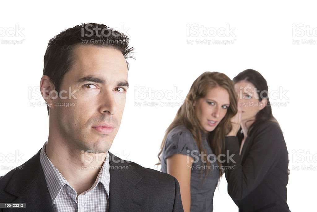 2 female office workers gossiping about male co-worker royalty-free stock photo
