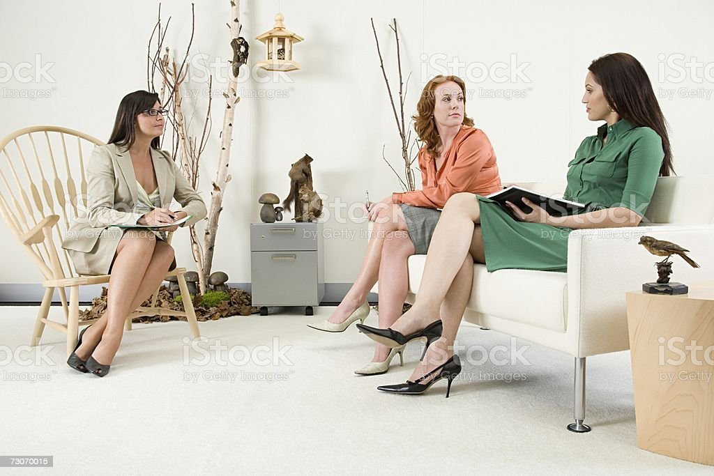Female office workers in meeting stock photo