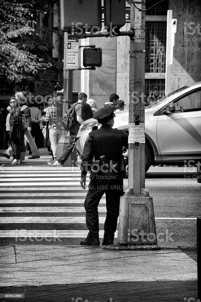 NYPD Female Officer Posted in Midtown Manhattan,New York City stock photo