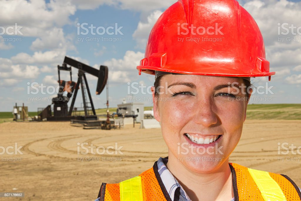 Female Oil Worker and Pumpjack stock photo