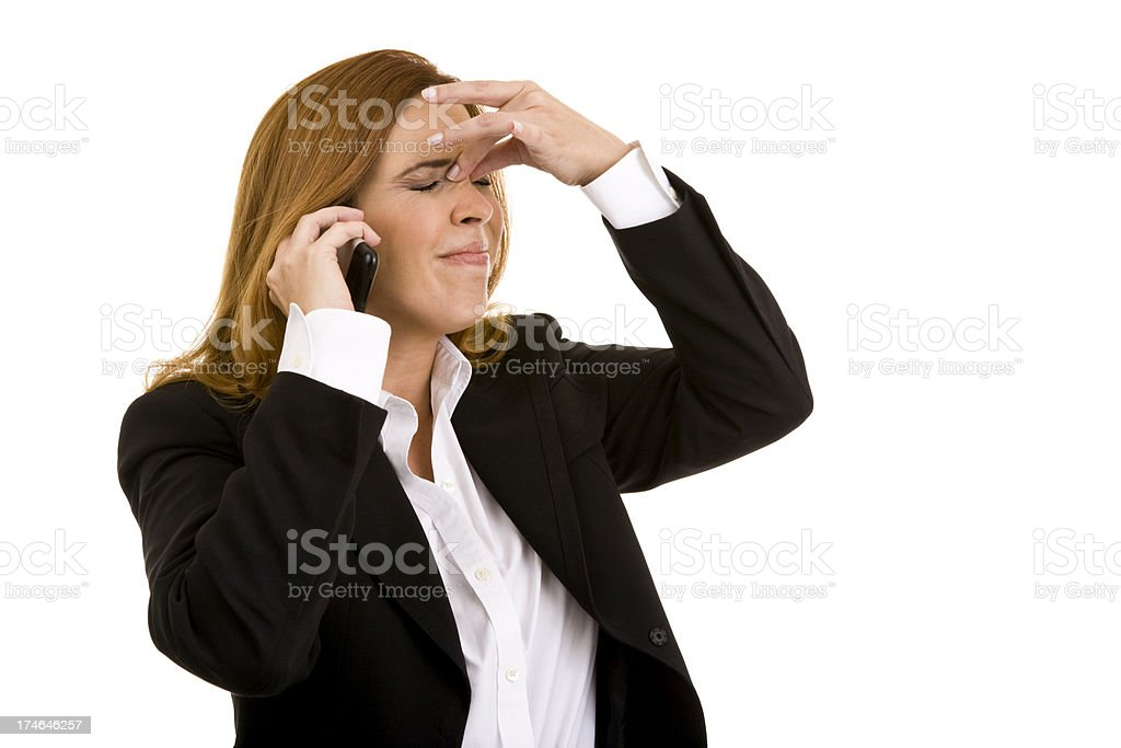 Female on cellphone gesturing hand on top of nose headache royalty-free stock photo