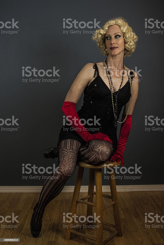 Female On  Stool In A Semi-Formal Pose royalty-free stock photo