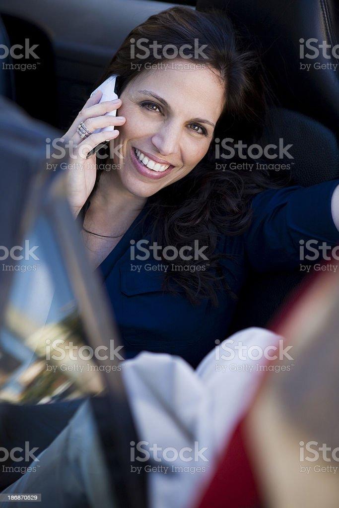 Female on telephone sitting in car stock photo