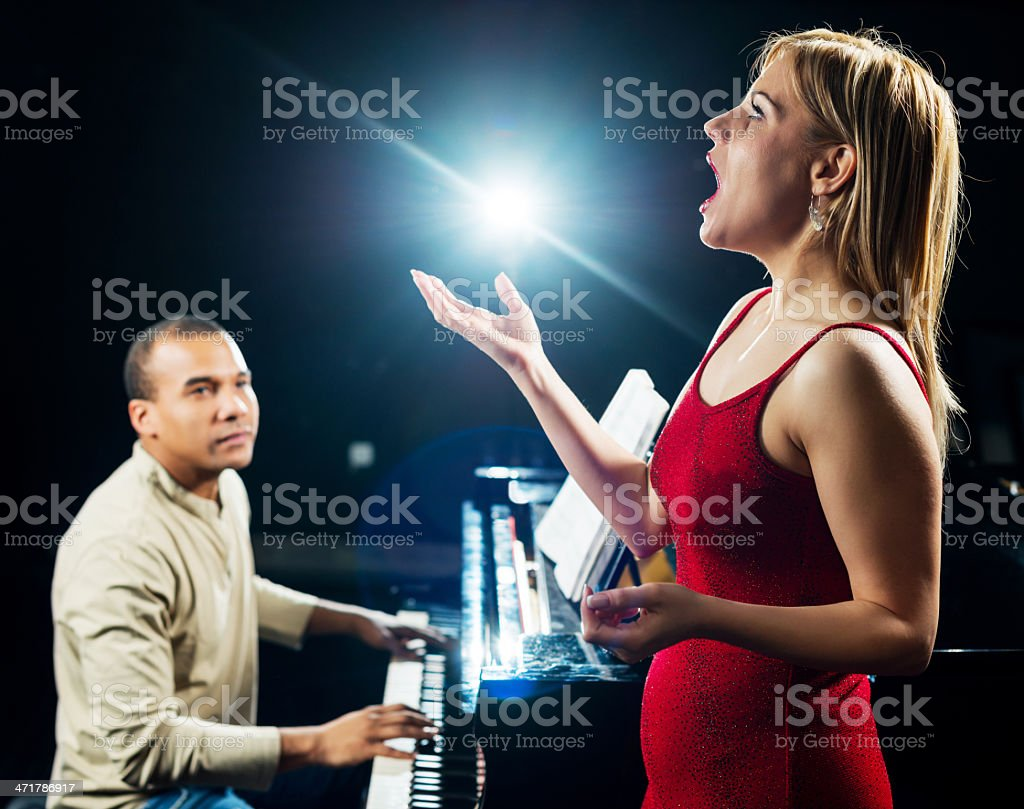Female opera singer with a pianist. royalty-free stock photo