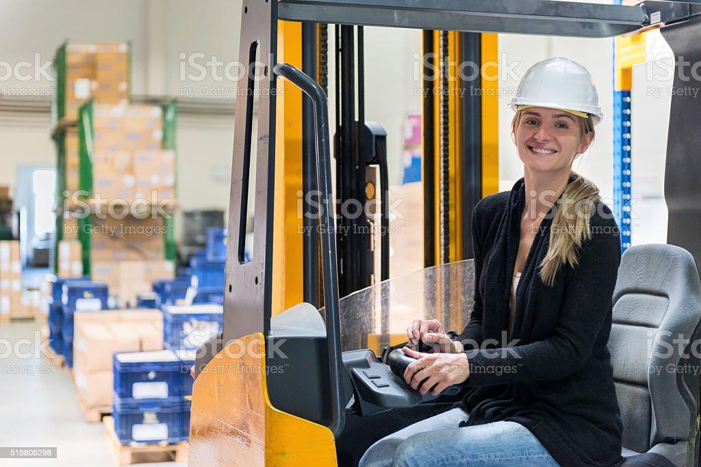 Female operator in warehouse stock photo