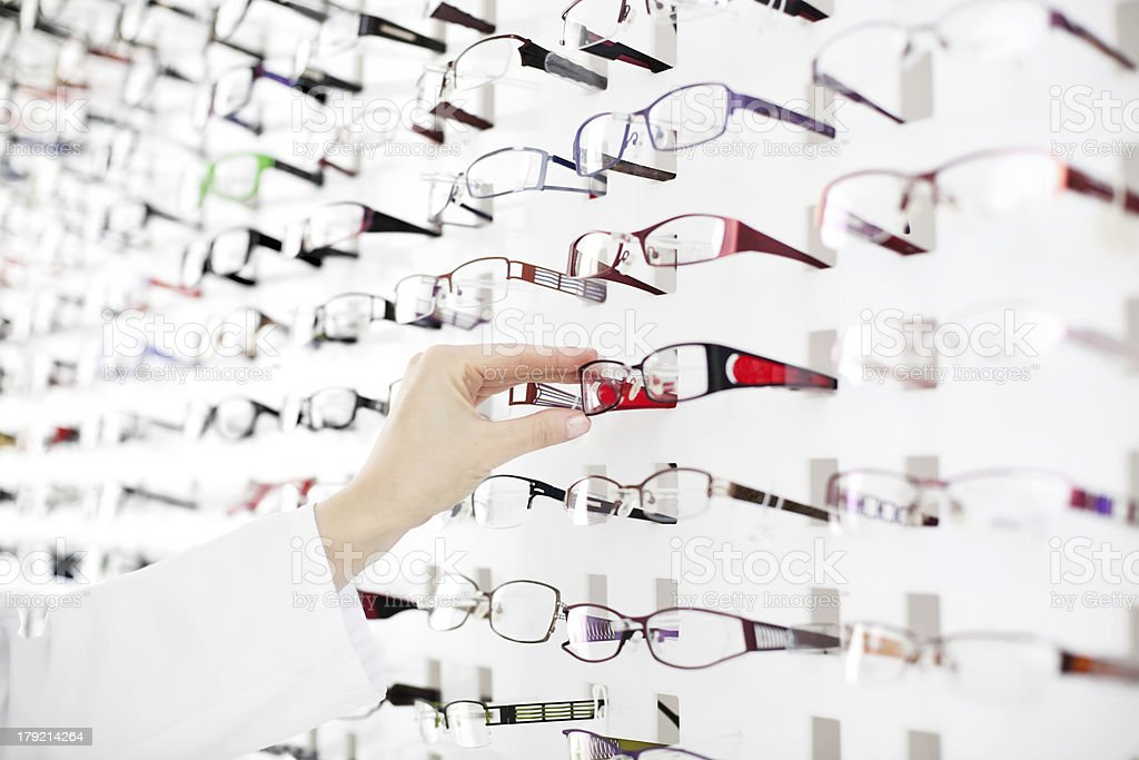 Female optician suggest glasses stock photo