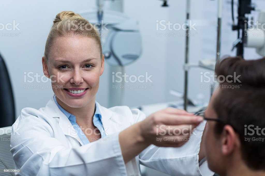 Female optometrist prescribing spectacles to patient stock photo