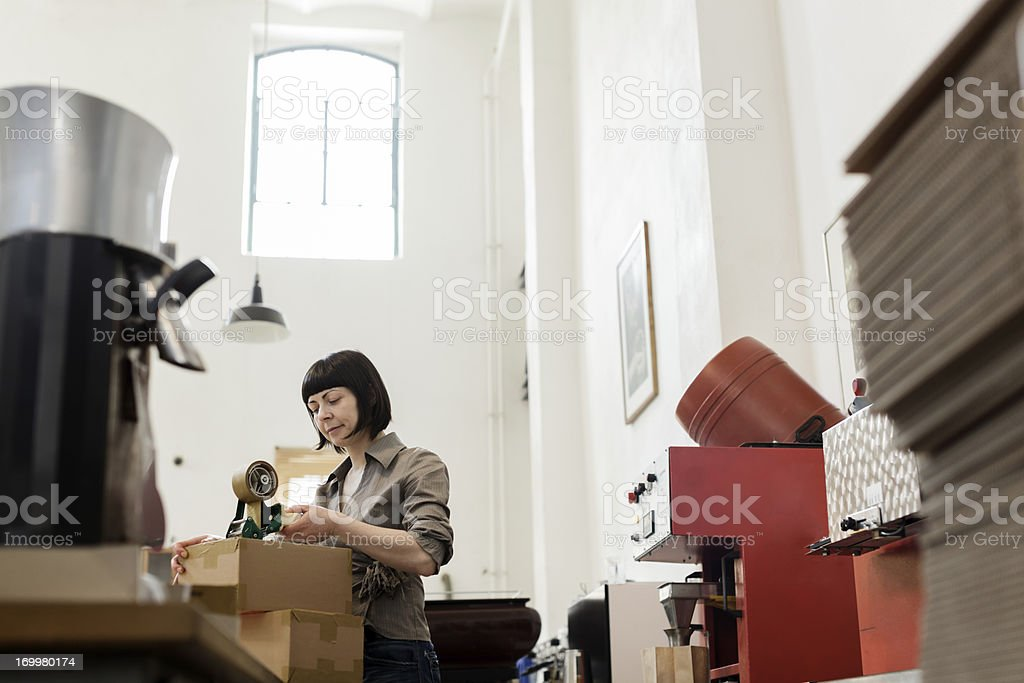 Female owner of a Coffee Roastery royalty-free stock photo